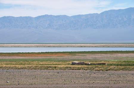 Mongolian shepherd's house on the background of the lake Dzergiin Tsagaan Nuur in Mongolia. Bumbat Khairkhan Ridge on background. Banco de Imagens
