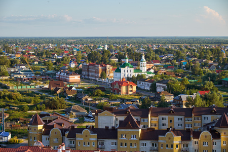 View on the modern residential quarters with the foothills Church of St. Michael the Archangel in the piedmont near Tobolsk kremlin. Tobolsk. Russia