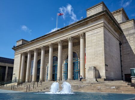 SHEFFIELD, ENGLAND - MAY 8, 2009: The neo-classical building of Sheffield City Hall dominated Barker's Pool with the glass-cased fountains. Sheffield. England