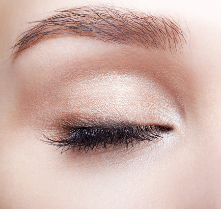 Closeup macro shot of closed human woman eye. Female with natural eyes makeup Stock fotó