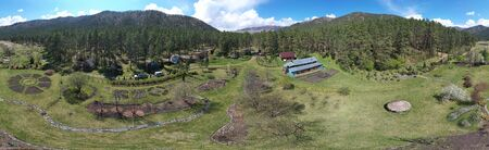 Drone bird's-eye panorama of Gorno-Altai Botanical Garden. Altai, Russia