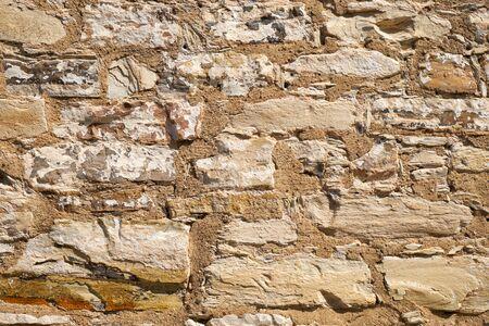 Texture del vecchio muro di pietra di mattoni. Sfondo muro di pietra Archivio Fotografico