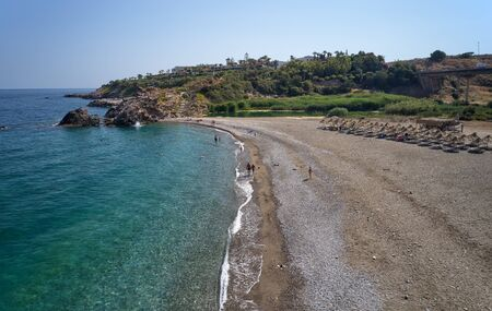 Aerial view from drone on Geropotamos pebble beach on Crete, Greece, Rethymno prefecture.