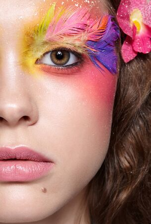 Close-up  shot of female face. Woman with bright stylish eyes make-up and false fashion feather eyelashes Reklamní fotografie - 130126413