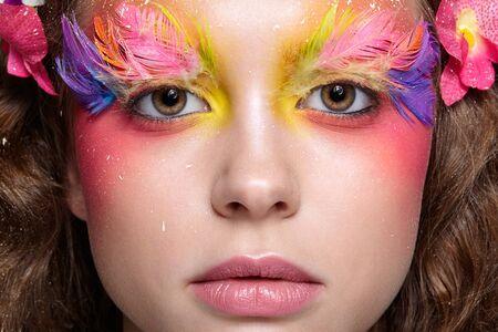 Close-up  shot of female face. Woman with bright stylish eyes make-up and false fashion feather eyelashes Reklamní fotografie - 130126459