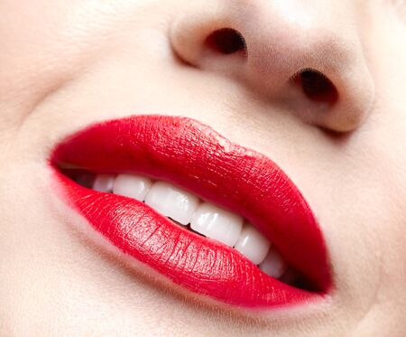 Closeup macro portrait of female part of face. Human woman red smiling, lips with day beauty makeup. Girl with perfect lips shape.