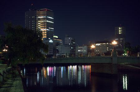 HIROSHIMA, JAPAN - NOVEMBER 23, 2007: The view of the Ota River with Aioi Bridge,  the aiming point for the Atomic bombing of Hiroshima, at the night lights. Hiroshima. Japan