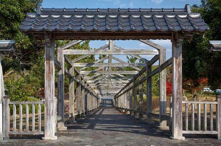 Wooden arbor pavilion in Japanese garden. Japan