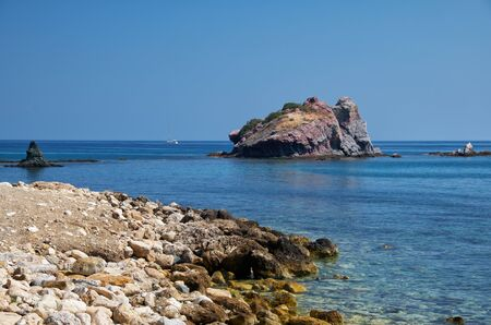 The view of the blue Takkas bay with large volcanic rock of Aphrodite near Baths of Aphrodite on the Akamas Peninsula. Cyprus