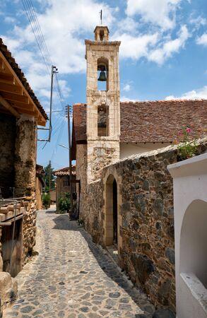 The view of the old Transfiguration of the Saviour (Metamorfosi tou Sotira) Church on the narrow street of old Kakopetria. Nicosia District. Cyprus