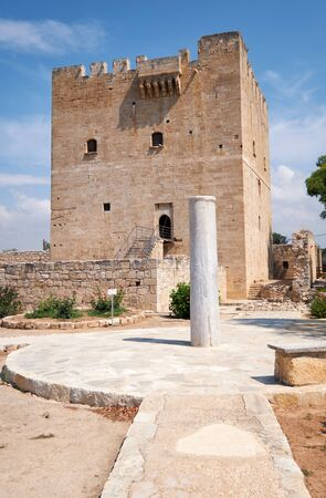 The view of the ruins of Kolossi Castle with the keep tower and stone pillar at the entrance to the bailey. Kolossi. Limassol District. Cyprus