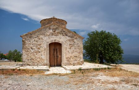 The view of the Byzantine style 12th-century church of Archangel Michael on the hill in Kato Lefkara village. Cyprus 写真素材