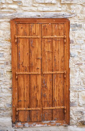 Old wooden door in the traditional stone house of Pano Lefkara village. Larnaca District. Cyprus.