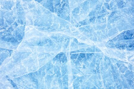 Surface of winter ice on Baikal lake in Siberia . Blue background of Ice texture