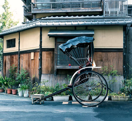 The cart of pulled rickshaw (ricksha) on the street of old Kyoto. Japan