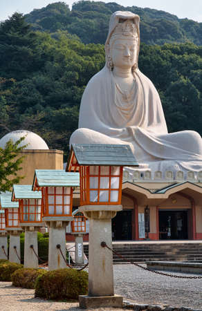 Kyoto, Japan - November 23, 2007: The view of the statue of Bodhisattva Avalokitesvara (Ryozen Kannon) over the shrine built by Hirosuke Ishikawa to honor the dead of World War II. Kyoto. Japan