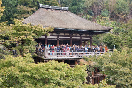 Kyoto, Japan - November 23, 2007: The large wooden stage in the main hall of Kiyomizu-dera temple which rises on the wooden pillars above the bright green vegetation of the hill. Kyoto. Japan 新聞圖片