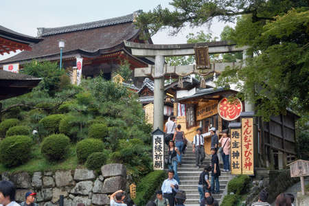 Kyoto, Japan - November 23, 2007: The torii gate and steps to the Jishu-Jinja Shrine located north of Kiyomizu-dera Temple and dedicated to the god of matchmaking and famous of their love stones.