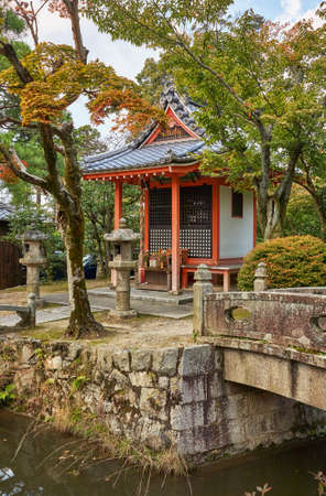 The small shrine over the watercourse with the contiguous stone bridges on the territory of Kiyomizu-dera (pure water) Temple. Kyoto. Japan
