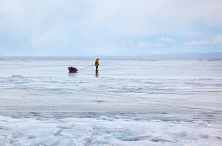 Tourist traveling on Baikal Lake in Siberia at winter time Standard-Bild