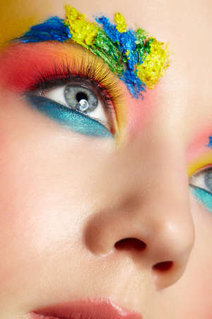 Close-up of teenager girl portrait with unusual face art make-up. Paint on brows. 免版税图像
