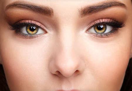 Closeup macro shot of human female face. Woman with natural face and eyes beauty makeup.