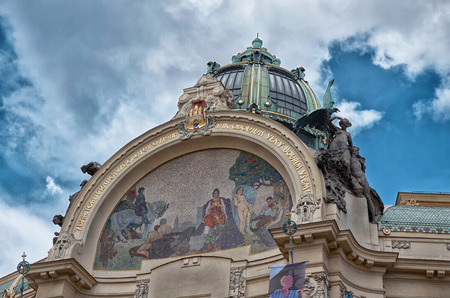 Czech Republic. Prague. Sculpture on the roof of the building. June 13, 2016