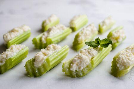 Celery with cream cheese, selective focus