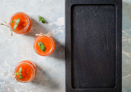 sweet and sour: Sweet sour sauce with vegetable pieces with copyspace, top view