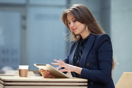 business woman working with tablet in cafe