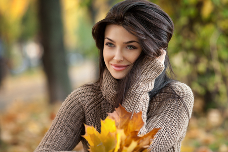 portrait of beautiful girl on yellow leaves. Outdoor