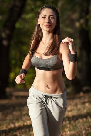 woman running outdoors training for marathon run