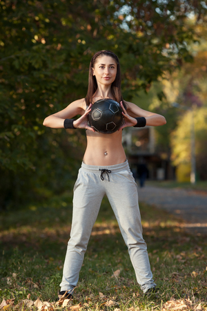 Young woman doing exercises with Ball