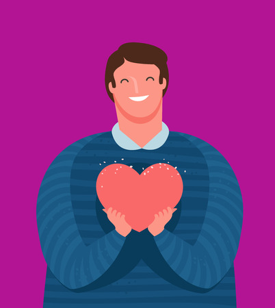 Cute guy holds tenderly a heart in his hands. Love, friendship concept.