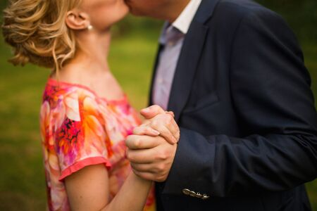 attractive lady: Attractive couple hugging in the park, close up. Stock Photo