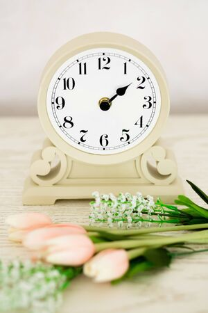 past midnight: Retro alarm clock with flowers on wooden rusty background