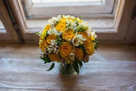 Beautiful wedding bouquet  on the windowsill background Zdjęcie Seryjne