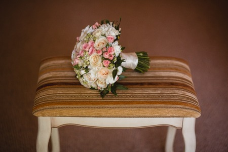 Beautiful wedding bouquet on the vintage chair.