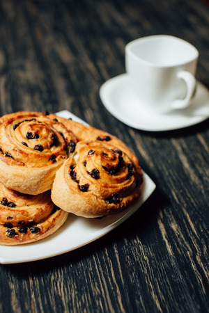 Delicious homemade bakery with chocolate on dark wooden table. 스톡 콘텐츠