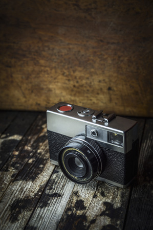 retro camera on a dark wooden background