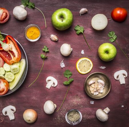 rustic food: concept of vegetarian food preparation of salad various vegetables and fruits pan on rustic wooden background top view close up