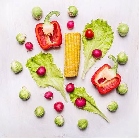 Delicious assortment of farm fresh vegetables  on wooden rustic background top view