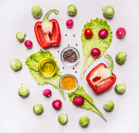 food ingredient: cooking vegetarian peppers, lettuce, sprouts, seasonings on wooden rustic background top view Stock Photo