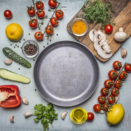 concept cooking vegetarian food ingredients laid out around the pan with spices, mushrooms, butter on wooden rustic background top view place for text
