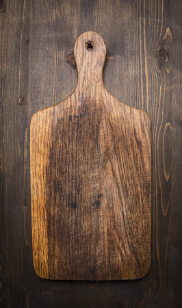 barbecue grill: old vintage wooden cutting board  on wooden rustic background top view close up