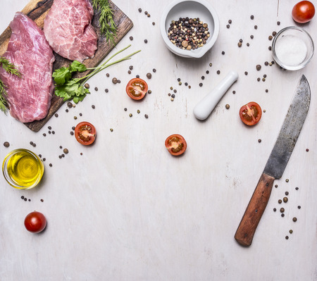 Ingredients for cooking Pork steak with vegetables and spices on wooden rustic background top view close up place for text,frame