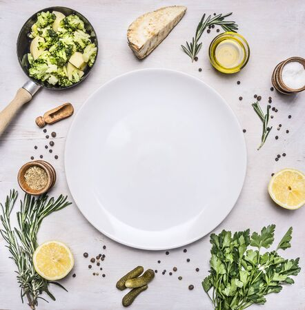 broccoli sprouts: Healthy vegetarian foods, broccoli sprouts in a small frying pan, oil and seasonings, herbs and lemon place for text,frame on wooden rustic background top view