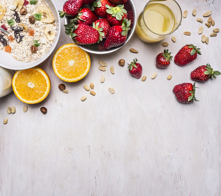 wholesome: the concept of a healthy and wholesome breakfast, cereal with nuts and fruit place for text,frame on wooden rustic background top view