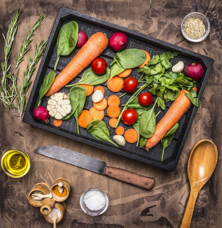 fresh concept: Fresh vegetables and ingredients for cooking in vintage wooden box on rustic background, top view, place for text. Vegan food , vegetarian and healthily cooking concept.
