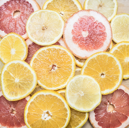 sliced ??oranges, lemons and grapefruits, the concept of useful citrus fruits, top view